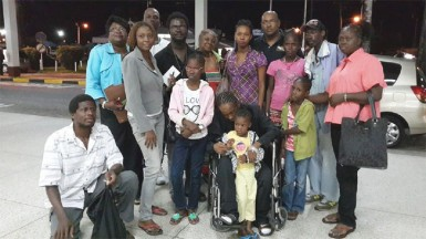 Colwyn Harding (in wheelchair) poses with family, friends and supporters shortly before he checked in at the Cheddi Jagan International Airport. He and his mother, Sharon (right) later left for Jamaica where he is expected to received additional medical attention.