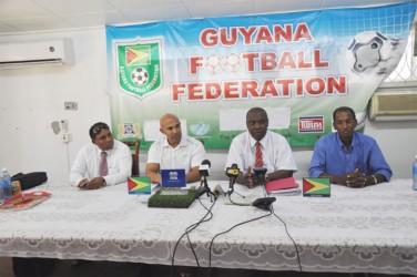 GFF President Christopher Matthias addressing the gathering at a brief press conference yesterday at the entity's section K Campbellville office while GFF Vice President Ivan Persaud (extreme left), Technical Director Mark Rodrigues (left) and GFF executive Committee member Keith O'Jeer (right) look on.