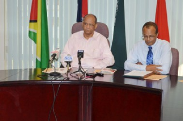 Home Affairs Minister Clement Rohee (left) and Coordinator of the Task Force, Michael Atherly (GINA photo)
