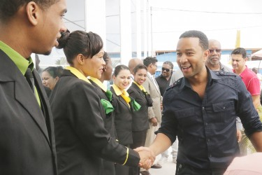 John Legend arrived here this afternoon for his much-anticipated concert. Here he greets Fly Jamaica crew members at the Ogle International Airport.