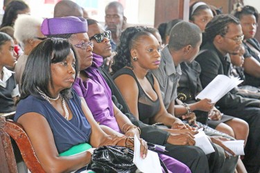 Terry Holder's eldest child Dawn Holder (left) and other relatives at the funeral