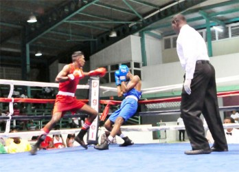 Imran 'Magic' Khan (red) in action versus Jamaican, Patrick Sahadeo. Khan won via a third round KO. (Orlando Charles photo)