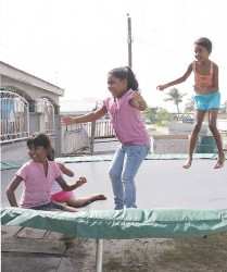 These young ladies were having fun on the trampoline at Jaden's birthday party.
