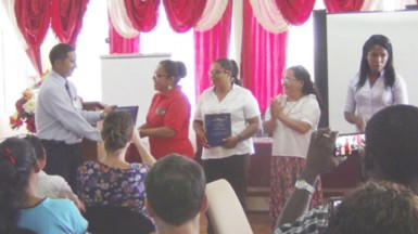 (from left to right) GBTI Lethem manager André Yhap presenting plaques to the 4 finalists - Rosamund Benn (Pomeroon women's), Alicia Gouveia (Waini Naturals) Ayli Cenepo Quinteros (Peru), Ebelin Patricia Solorzano (Peru)