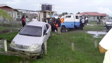 The vehicle being towed from the drain by the police.