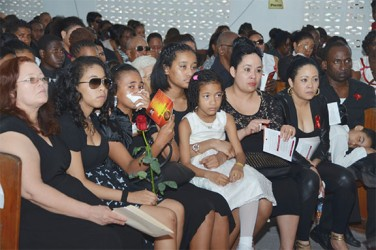 Relatives at Trevor Rose's funeral service yesterday.