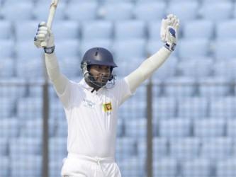 Kumar Sangakkara celebrates reaching his triple century.