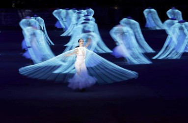 Performers participate in the opening ceremony of the 2014 Sochi Winter Olympics, yesterday. REUTERS/Phil Noble