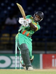 Guyana's Shivnarine Chanderpaul strikes one of his three sixes in his topscore of 65 albeit in a losing cause yesterday as Jamaica won the final preliminary game by the narrow margin of 10 runs. (WICB media photo)