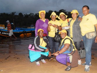 GWMO President, stooping at right, and other members of the organisation during their trip to Cuyuni.