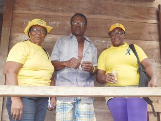 GWMO President Simona Broomes and member Irene Sears flank miner Wendell Wade who  has been a miner for 50 years, 27 of which were spent in the Cuyuni River area.
