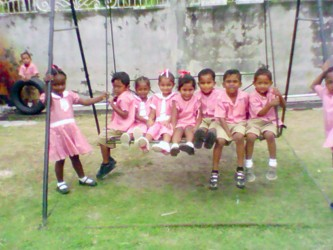 Students from Pitt's Play School on the swing