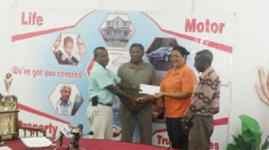 Hand-in-Hand's Human Resources Administrative Manager Zaida Joaquin, right, hands over the sponsorship cheque to Rabindranauth Saywack, assistant treasurer of the West Berbice Cricket Association.