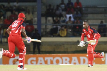 Darren Bravo and Jason Mohammed scamper the winning run. (Photo courtesy of WICB media)