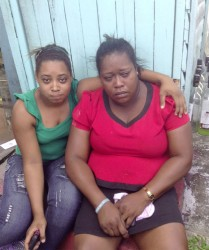 Carla Archer (left), Vanessa Higgins's 18-year-old daughter, comforts her mother after yesterday's fire.