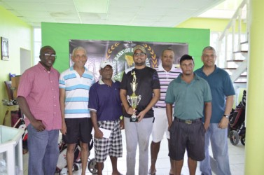 George Bulkan (with trophy) and members of the successful Underdogs team pose with Banks DIH Sales and Marketing Executive Carlton Joao and Citizens Bank Senior Credit and Marketing Manager Lindel Harlequin.