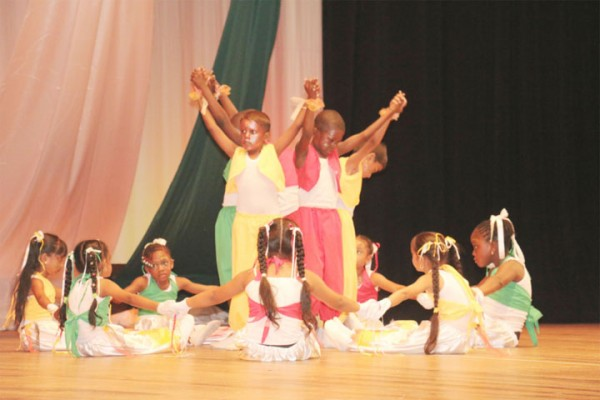 Pupils of New Market Primary in Region Six performing `Go light your world' in the religious beliefs segment.