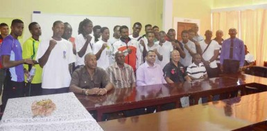 The officials along with the pugilists competing in the three-day, four-nation, International Goodwill tournament take a photo opportunity with Minister of Sport, Dr. Frank Anthony (seated centre).