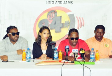 Hits and Jams executive, Kerwin Bollers (second from right) making a point at Friday's launch of the H&J Day of Sports. (Orlando Charles photo)