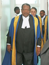 President of the Caribbean Court of Justice (CCJ) Sir Dennis Byron leads other judges into the Guyana International Conference Centre, Liliendaal, East Coast Demerara yesterday morning for the inaugural sitting of the CCJ here. Justice Byron, who is the second president succeeded Justice Michael de la Bastide in 2011. (Photo by Arian Browne)
