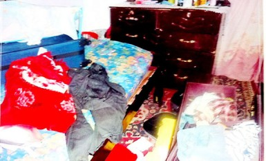 One of the ransacked rooms of the house.