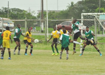 MiloU-20 football action on Sunday at the Ministry of Education ground. (Orlando Charles photo)
