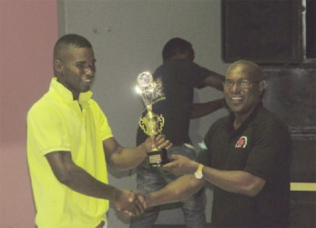 Dennis Thomas receiving his best boxer award from president of the GBA, Steve Ninvalle. (Orlando Charles photo)