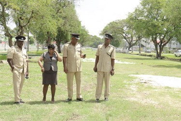 (from left to right) Superintendent Errol Watts, acting Town Clerk Carol Sooba, 'A' Division Commander George Vyphuis and another senior policeman discussing preparations for Mash Day at the Merriman Mall yesterday.  (Arian Browne photo)