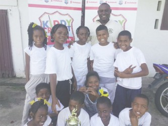 South Ruimveldt Primary School cricketers and their teacher Royden Profitt