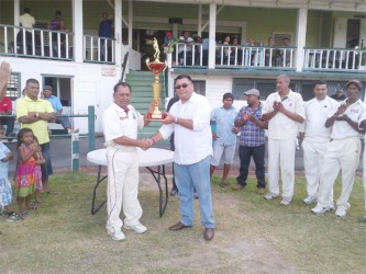 Raj Singh hands over the trophy to captain of the winning team Sheik Mohamed.