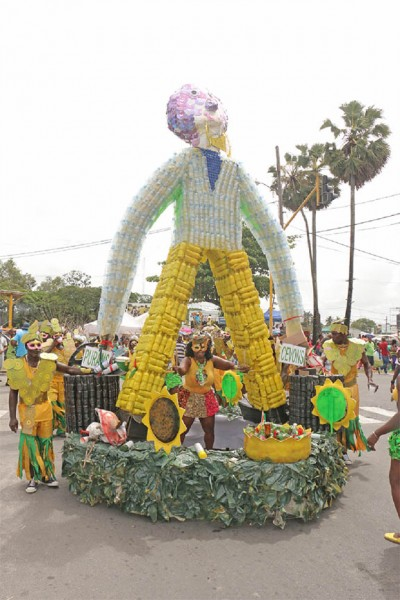 "Timely:  GT Recycler's float ""Recycling is Everybody's Business"" depicted a 10 foot Moongazer and the Massacooramaan. The group's depictions used approximately 80% recycled items. (Arian Browne photo)"