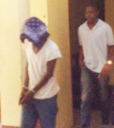 Adrian Daly (left) and Troy Harris being escorted to the holding cell yesterday.