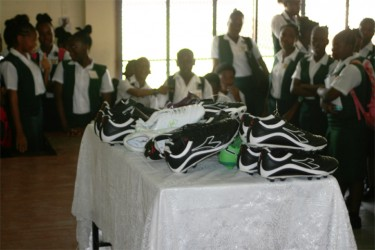 Some of the soccer boots on display during the MHS special assembly.