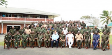 Officers' conference: President Donald Ramotar (centre) with Chief of  Staff, Brigadier Mark Phillips and other senior and junior staff of the Guyana Defence Force on the lawns of the Officers' Mess, Base Camp Ayanganna for the annual officers' conference yesterday. (GINA photo)