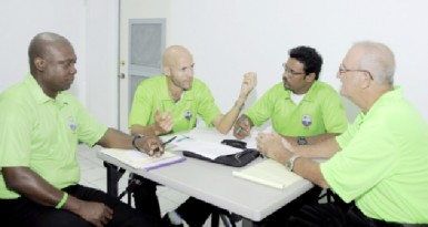 Umpires workshop: From left, Nigel Duguid, Christopher Taylor, Zahid Bassarath and Goaland Greaves in discussion. Three WICB workshops commenced in Jamaica this week for umpires, match referees and video analysts from across the region. (WICB photo)