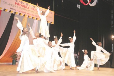 Region Six's Corentyne Comprehensive in an energetic dramatization of `Trust in God' in the religious beliefs section of the Children's Mashramani Contest at the National Cultural Centre on Wednesday.