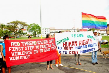 """Red Thread and Guyana Trans United banners on display at Parade Ground. Over 300 persons from all walks of life took part in the Walk for Equality on Sunday, February 9, to say """"No to violence""""."""