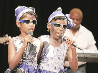 Mekyla Belgrave and Angelica Bassoo of the Resource Unit for the Blind and Visually Impaired performing `I can' in the calypso segment of the children's Mashramani contest finals yesterday at the National Cultural Centre.