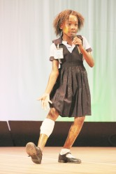 Tranisha McPherson of Smith's Memorial Primary performing her song titled 'Wan Day Mash can't wuk' during the calypso competition yesterday at the National Cultural Centre. (Photo by Arian Browne)