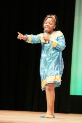 Winfer Gardens Primary's Kezia Conway performing her piece 'Teach the Children' for the crowd during the Children's Mashramani Competition Calypso segment yesterday at the National Cultural Centre. (Photo by Arian Browne)