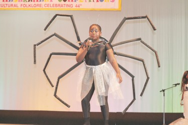 Latoya Cave of Stella Maris Primary performing her calypso 'Folklore' yesterday at the National Cultural Centre. (Photo by Arian Browne)