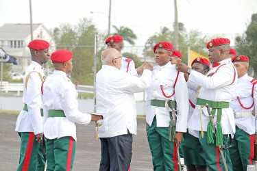 President Donald Ramotar (third from left) and Chief of Staff of the Guyana Defence Force Brigadier Mark Phillips today decorating the Best Graduating Student, Ensign Simon Gordon with badges. Gordon was the Best Student of Standard Officers' Course #46.