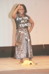 'Woman' being performed by Green Acres Primary's Genesia Samuels in the calypso category of the Children Mashramani Competition yesterday. (Photo by Arian Browne)