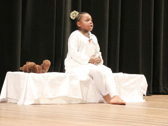 Jazara Williams of Green Acres Primary performing `I forgive you daddy'  in the dramatic poetry segment of the children's Mashramani contest finals yesterday at the National Cultural Centre.