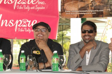 From left yesterday are Grammy award-winning Christian singer, Isaac Houghton and promoter Yog Mahadeo. They were at a press conference at the Princess Hotel speaking about preparations for last night's gospel concert at the National Stadium.