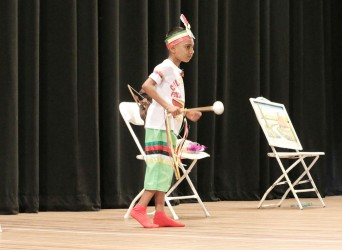 Mohamed Hussain of Blairmont Primary bringing to life his Mashramani theme in the dramatic poetry segment of the children's Mashramani contest yesterday at the National Cultural Centre.