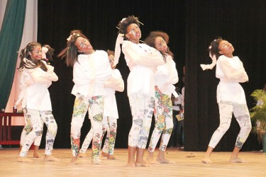 Region Four Diamond Secondary students performing `My own world' in the social commentary segment of the Children's Mashramani Contest at the National Cultural Centre on Wednesday.