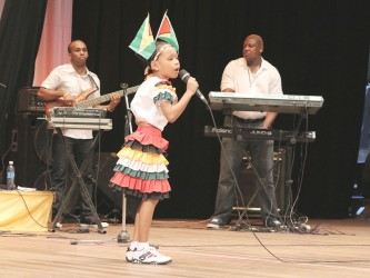 Sarah Fredericks of Mainstay Lake, Region Two singing `People in Society' in the calypso segment of the children's Mashramani contest yesterday at the National Cultural Centre.