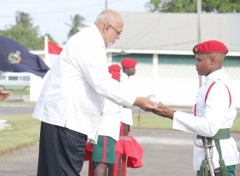 President Donald Ramotar today presenting the Sword of Honour to Simon Gordon, Best Student of Standard Officers' Course #46 at the Drill Square Base Camp Ayanganna, Thomas Lands.