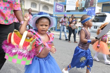 My basket is too heavy! This young one from the Festival City Day Care Centre seems to be a bit overwhelmed during a mini Mash parade today (Photo by Arian Browne)